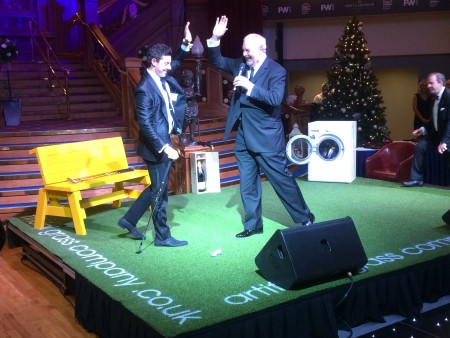 Golf superstar Rory McIlroy chips off the Artificial Grass Company's putting grass.